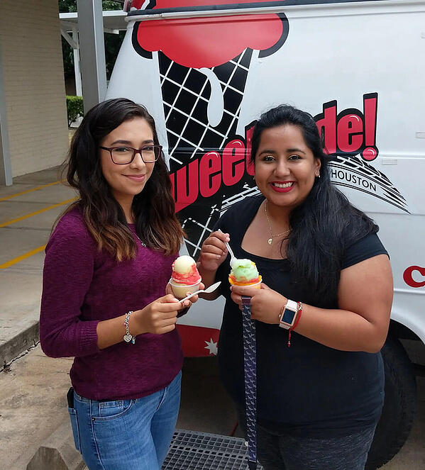two young women holding ice cream