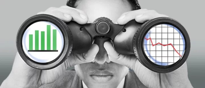 man using binoculars with charts placed on eyeholes
